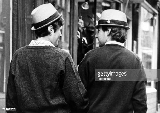18th September 1964 Great Britain A young couple dressed in casual Mod gear with matching hats By 1964 many of Britain's youth fell into 2 factions...