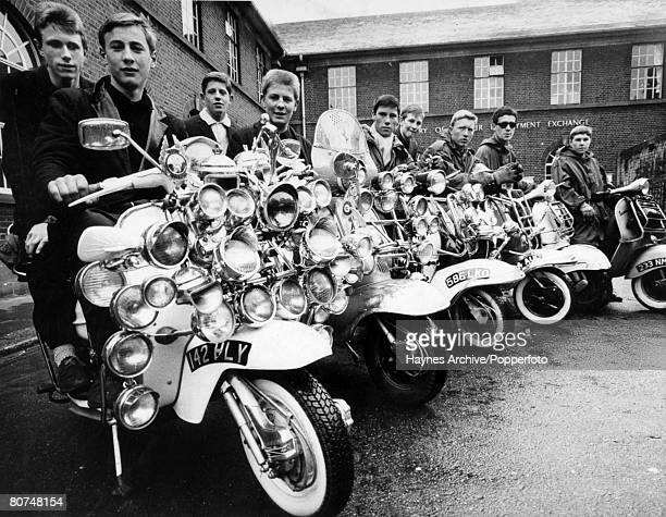 8th May 1964 Great Britain Young Mods with their scooters one which boasts 27 lamps plus horns mirrors badges and chrome mascots By 1964 many of...