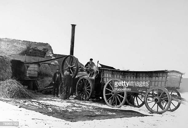 Social History People Farming Northamptonshire England pic circa 1900 Threshing in the snow at Cransley near Kettering