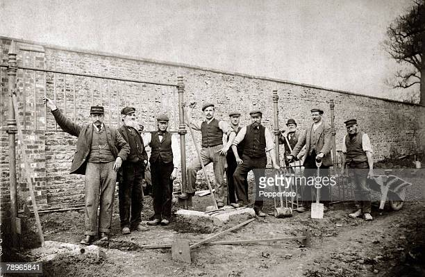 Social History People Northampton Northamptonshire England pic circa 1890's Workers pose for a photograph as they work on a wall at Abington Park...