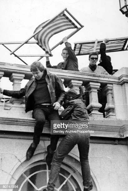 18th May 1964 Brighton Two Rockers flee from Mods who are about to hurl deck chairs at them during fighting at the seaside By 1964 many of Britain's...