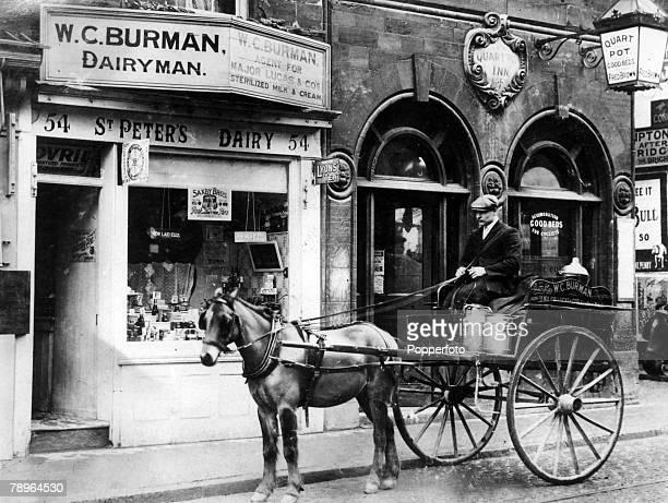 circa 1910 NorthamptonNorthamptonshire England A scene in Marefair Northampton showing a horse and trap WCBurman dairy and The Quart Pot Inn