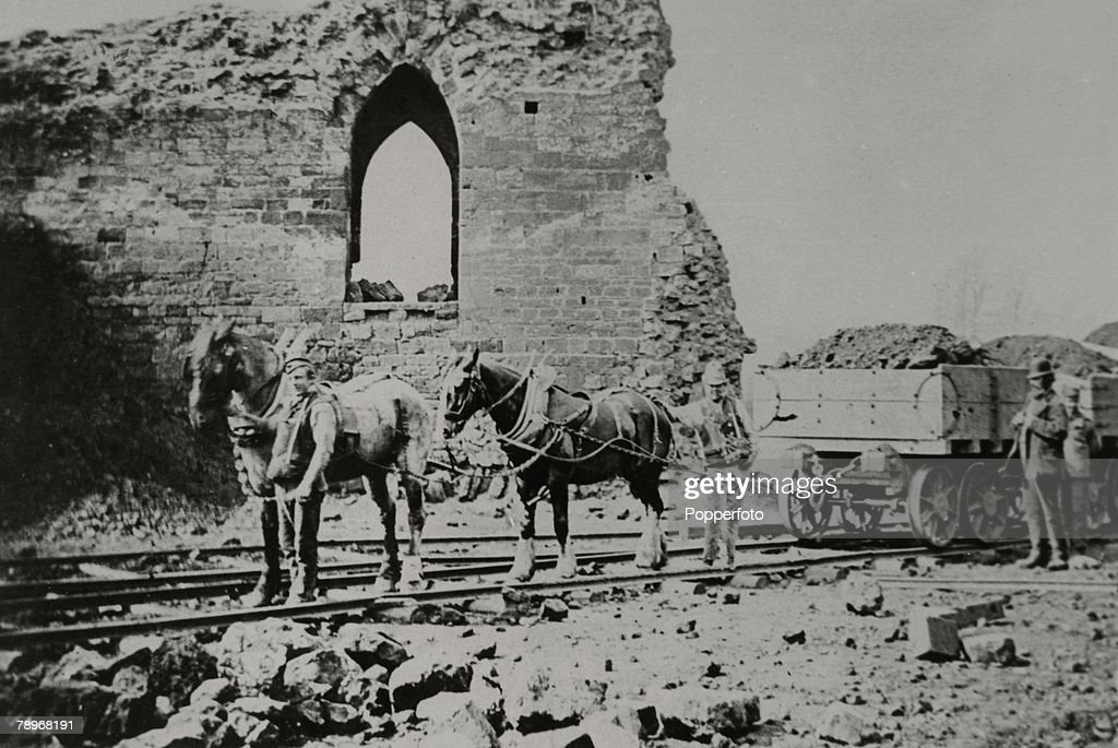 Social History. pic: circa 1870's. England, Northamptonshire, Northampton. The demolition of Northampton Castle with workmen using horses and cart to remove the rubble. : News Photo