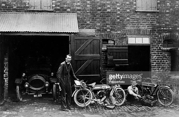 circa 1920's Northampton Northamptonshire England RevBHDavies the vicar of Holy Sepulchre Church Northampton and his curate prepare motorcycles for a...