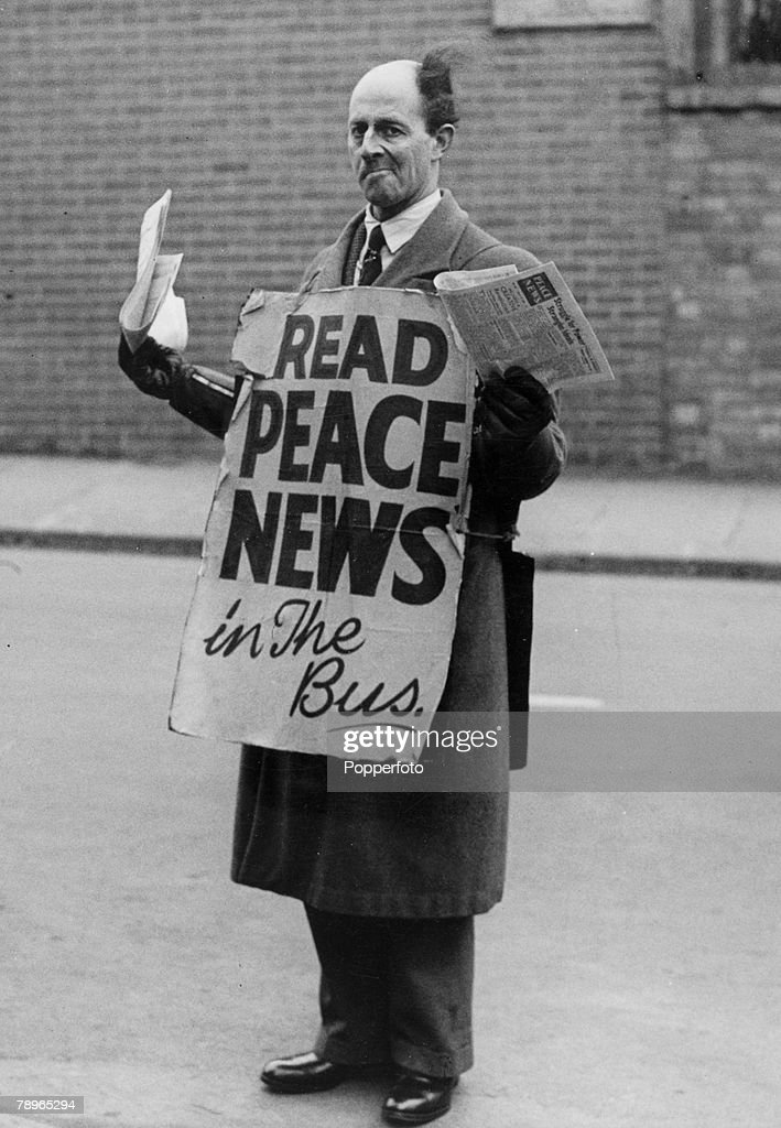 """Social History. War and Conflict. World War Two. pic: circa 1943. Northampton, Northamptonshire, England. Stanley Seamark, a pacifist, pictured outside the Bus Station in Derngate, Northampton, offering the """"Peace News"""" to bus travellers. : News Photo"""