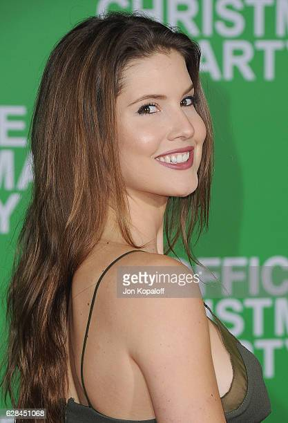 Social influencer Amanda Cerny arrives at the Los Angeles Premiere Office Christmas Party at Regency Village Theatre on December 7 2016 in Westwood...