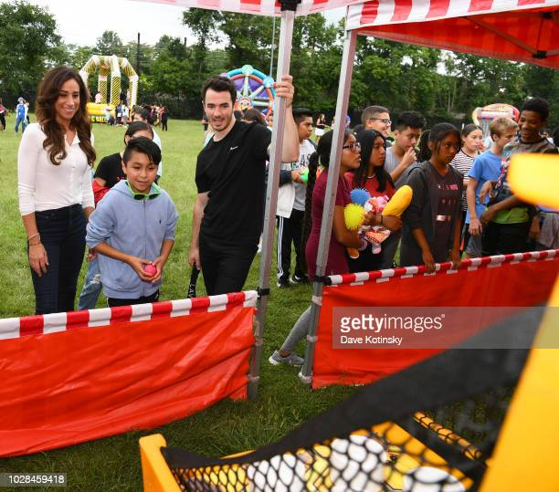 Social Influencer Danielle Jonas and recording artist Kevin Jonas enjoy activities as she attends as Vera Bradley partners with Blessings In A...