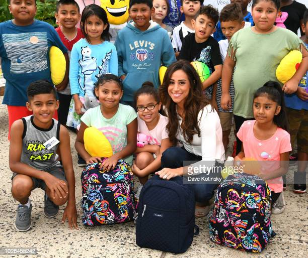 Social Influencer Danielle Jonas poses with students as she attends as Vera Bradley partners with Blessings In A Backpack to continue BackToSchool...