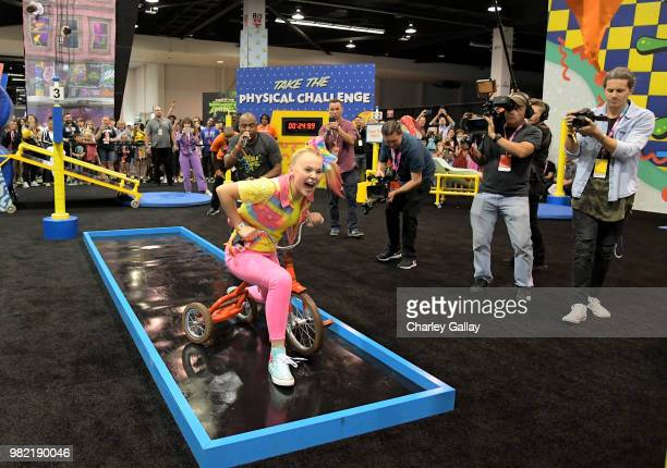 Social Influencer Nickelodeon Star JoJo Siwa experiences the Double Dare obstacle course at Nickelodeon's booth at 2018 VidCon at Anaheim Convention...