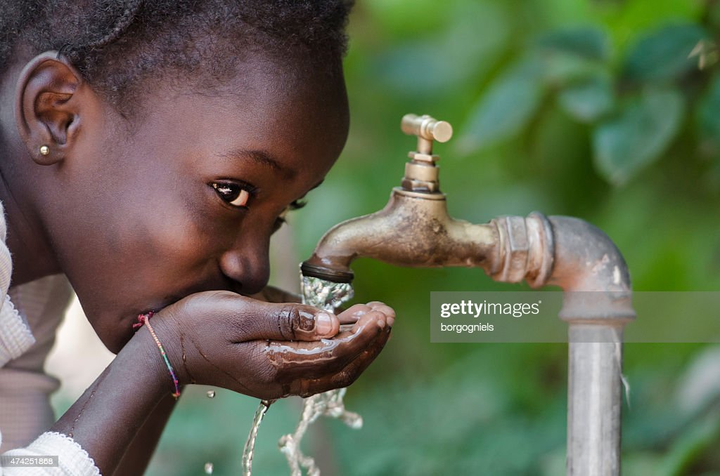 Social Issues: African Black Child Drinking Fresh Water From Tap : Stock Photo