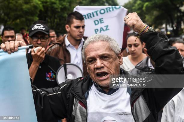 Social leaders from the Comuna 13 neighborhood chant slogans during a protest against the militarization and the lack of social programs in the...