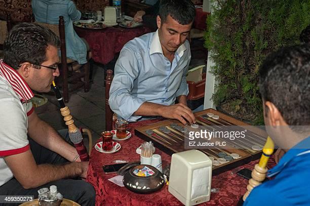 Social life at an outdoor restaurant along Kabasakal Cd, near the Sultanahmet Camii .