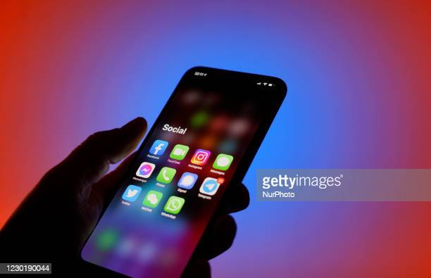 Social media applications are seen on an iPhone in this photo illustration in Warsaw, Poland on December 17, 2020. Facebook has disabled several...