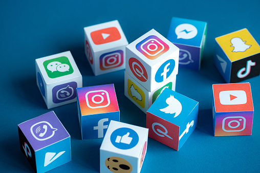 Social Media Apps Logotypes Printed on a Cubes 1173494845