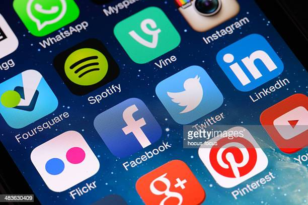 social media apps on iphone screen - marketing icons stock photos and pictures