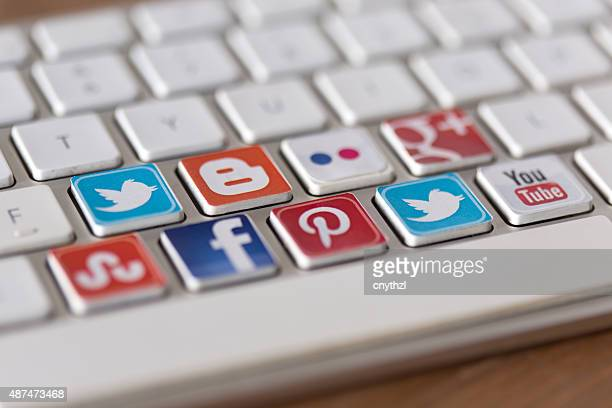 social media communication keyboard - social media icon stock photos and pictures