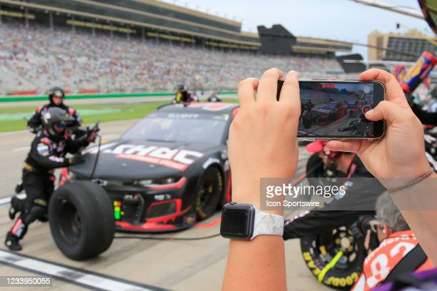 Social media content provider records the pit stop of Chase Elliott, #9 Hendrick Motorsports, Chevrolet Camaro Adrenaline Shoc on her iPhone during...