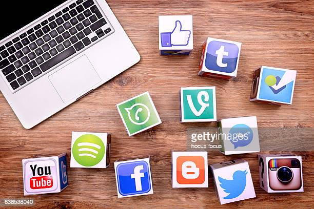 social media cubes and laptop on desk - strategy stock photos and pictures