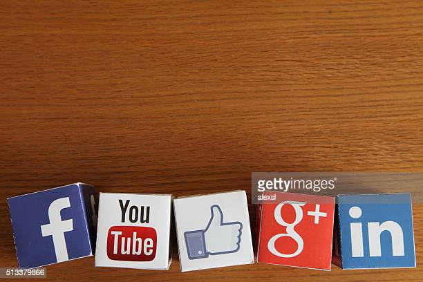 Social media icons cubes on wooden desk background