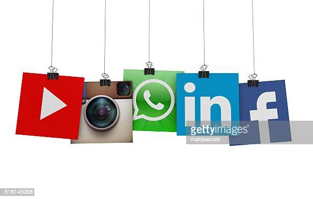 social media icons hanging on strings - marketing icons stock photos and pictures