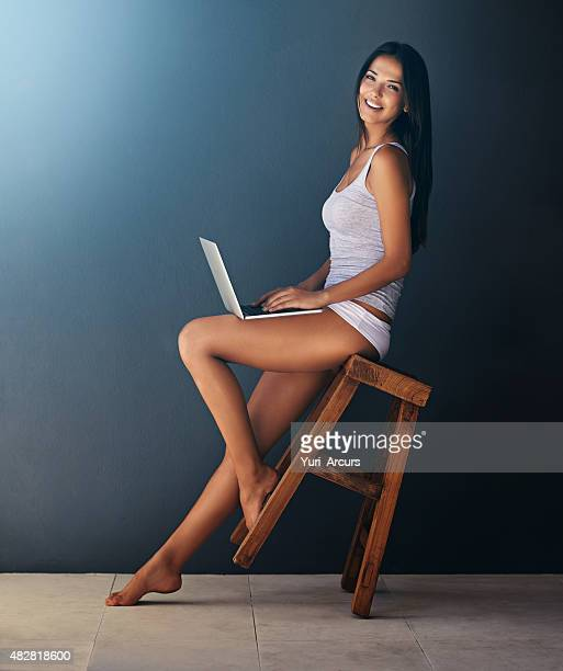social media in comfort! - long legs women stock photos and pictures