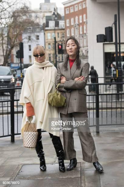 Social media influencer and consultant Sandra Hagelstam wears a Pringles of Scotland cape Staud bag Poppy Lissiman sunglasses and Gianvito Rossi...