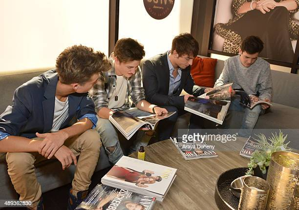 Social media influencers Christian Collins Crawford Collins Wesley Stromberg and Aaron Carpenter read Vanity Fair magazines during Vanity Fair Social...