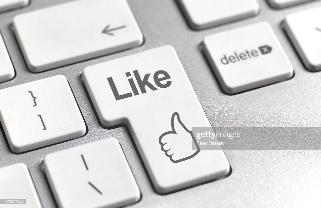 Social media 'Like' symbol on keyboard : Stock Photo