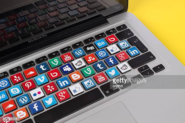 social media logos on macbook keyboard - google brand name stock pictures, royalty-free photos & images