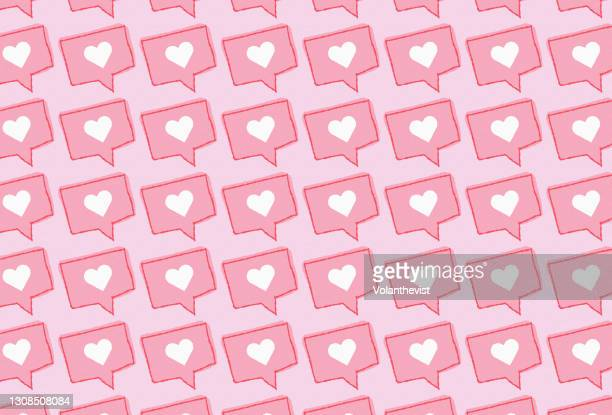 social media love red heart icon on pink background - facebook stock pictures, royalty-free photos & images