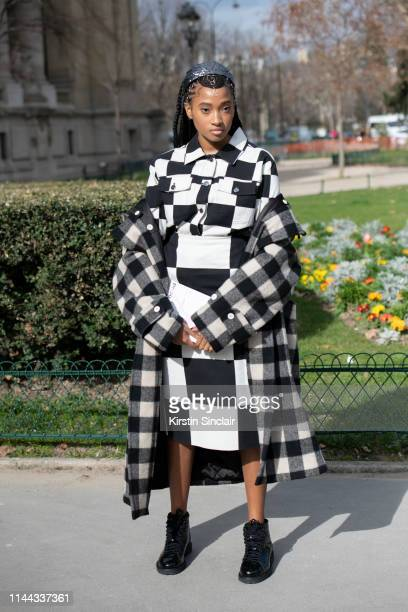 Social media manager for Barneys NYC Candace Marie Stewart wears an Art 13 coat Yana Markova hair accessories Marimekko shirt and skirt and Adidas...
