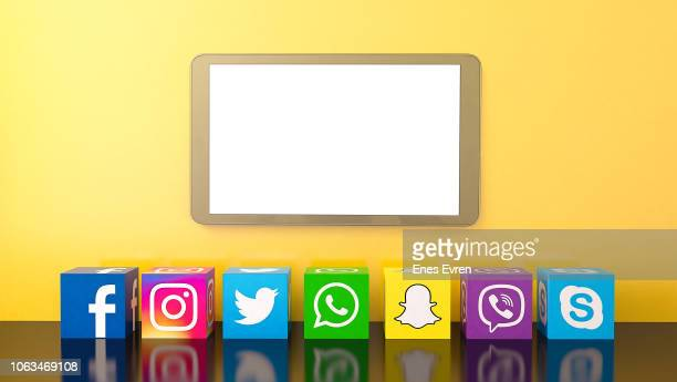 Social media services icons with digital tablet and copy space on yellow background