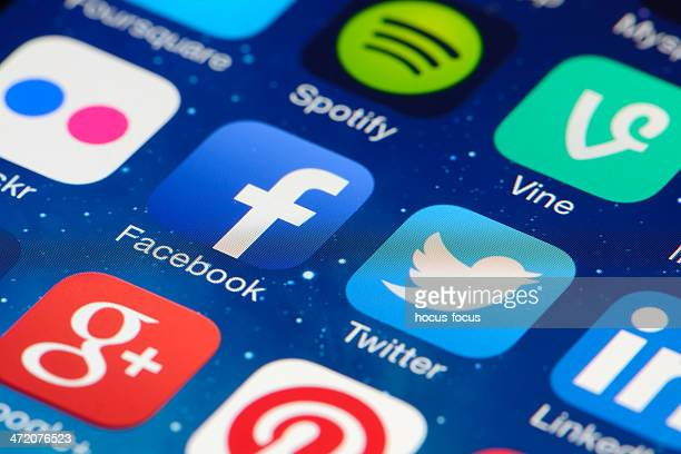 social networking apps on iphone screen - marketing icons stock photos and pictures