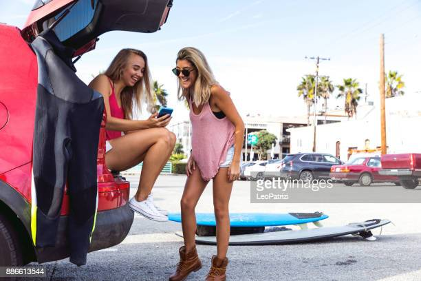 social networking, sharing our surf day - la beach stock pictures, royalty-free photos & images