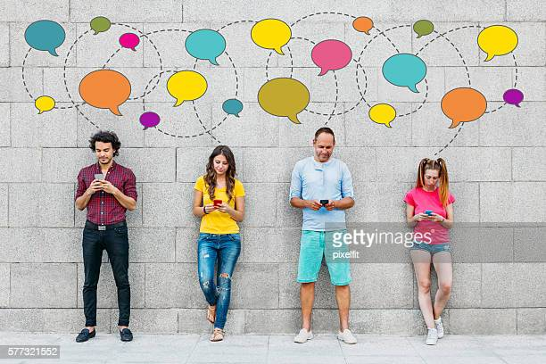 social people - gossip stock pictures, royalty-free photos & images