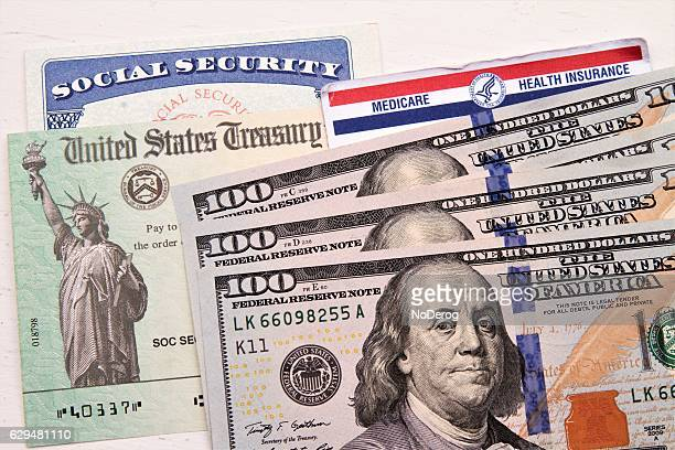 social security and medicare cards, treasury check, hundred dollar bills - social security stock pictures, royalty-free photos & images