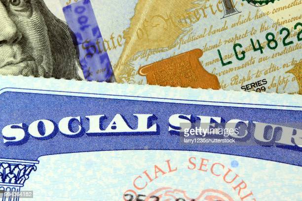 social security card and us currency dollars - shutterstock stock pictures, royalty-free photos & images