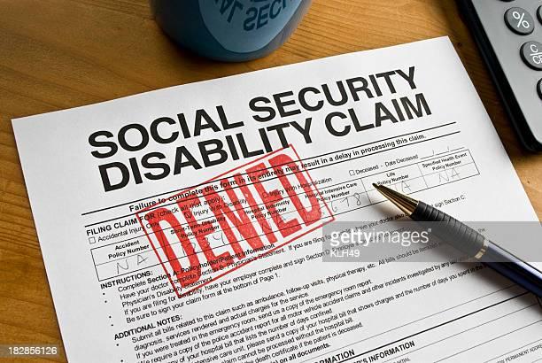 Social Security Claim Denied on a desk