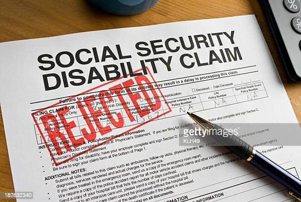 A social security disability claim form stamped REJECTED