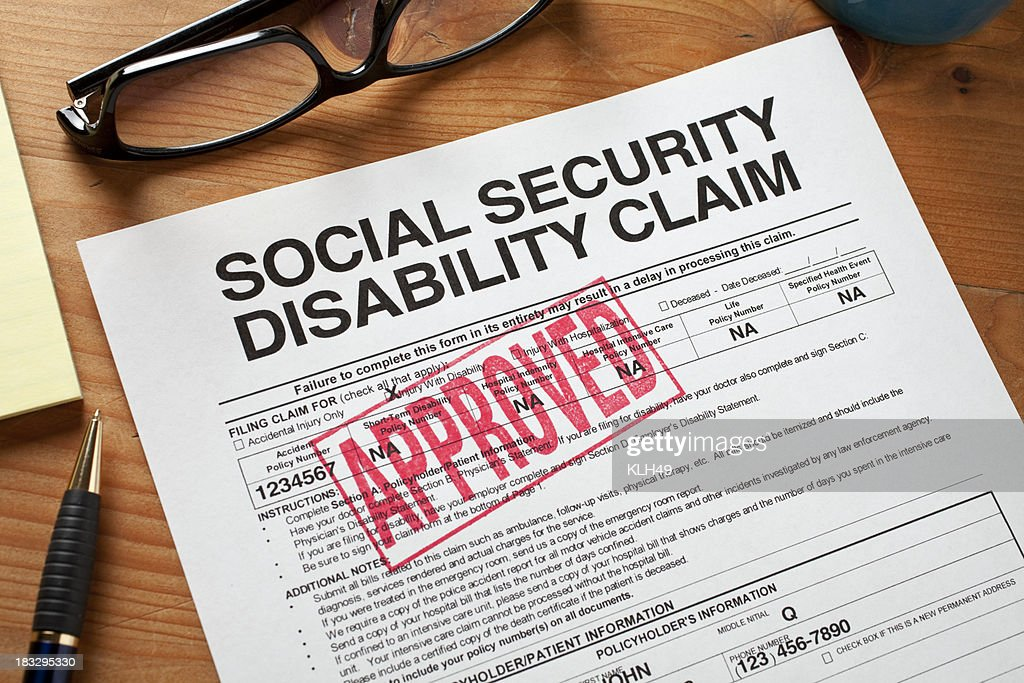 Social Security Disabilty form stamped APPROVED. : Stock Photo