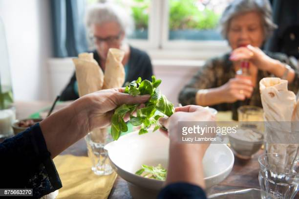Social Seniors: senior women making lunch