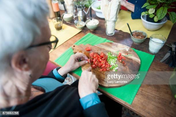 Social Seniors: senior women making lunch