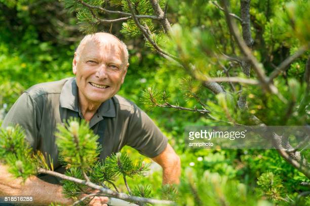 Social Seniors, smiling active senior in wood