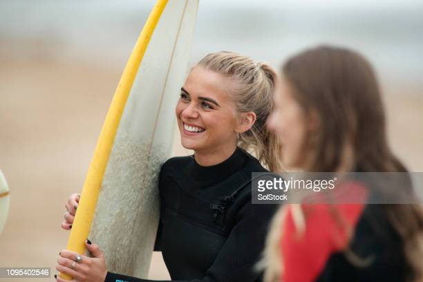 social surfers at the beach - surf stock pictures, royalty-free photos & images