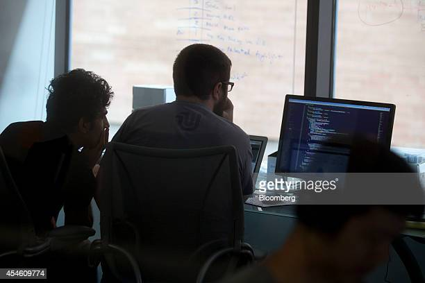 Social Tables Inc engineers work at the company's headquarters in Washington DC US on Thursday Aug 14 2014 Success stories like Social Tables' are...