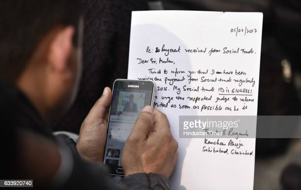 Social trade investors writing a letter to the government during a protest at Jantar Mantar they demanding the release of owner of the trade social...