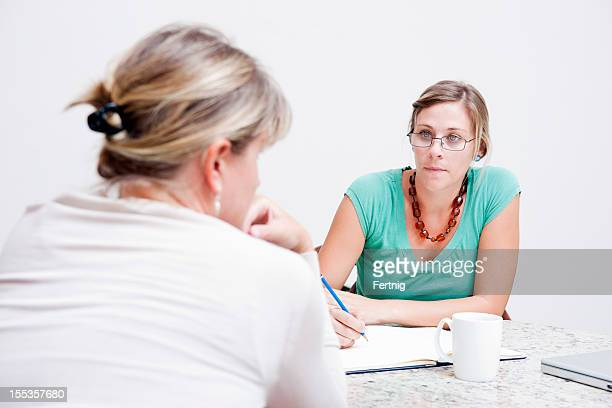 Social worker consulting with a client