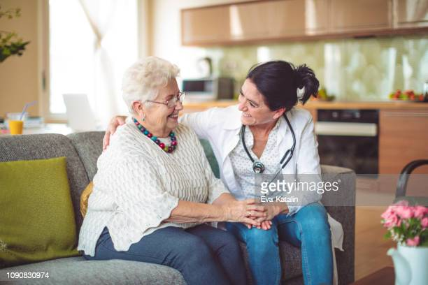 social worker is visiting a senior woman - social issues stock pictures, royalty-free photos & images
