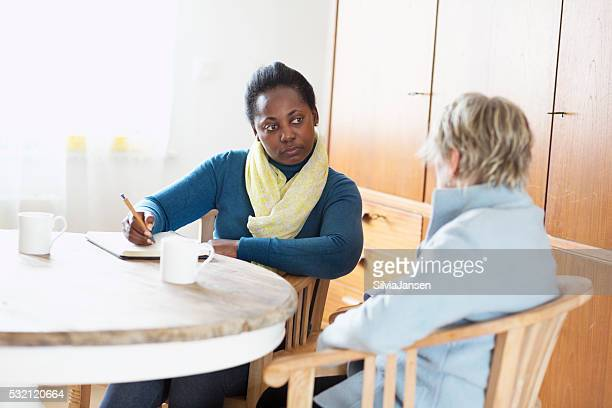 social worker meeting a client