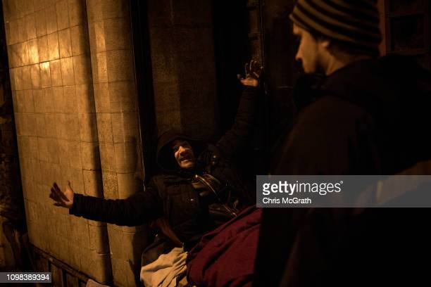Social worker Miklos Molnar from Oltalom Karitativ Egyesulet talks with a homeless man on the street on January 16, 2019 in Budapest, Hungary. In...